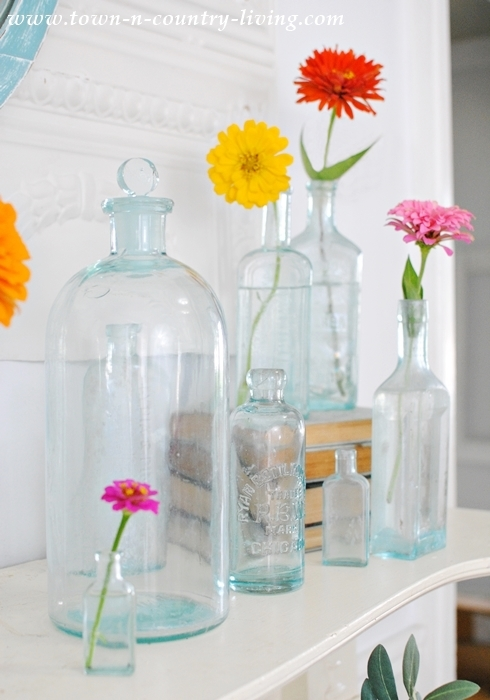 Summer Mantel of Vintage Bottles and Cheery Zinnias