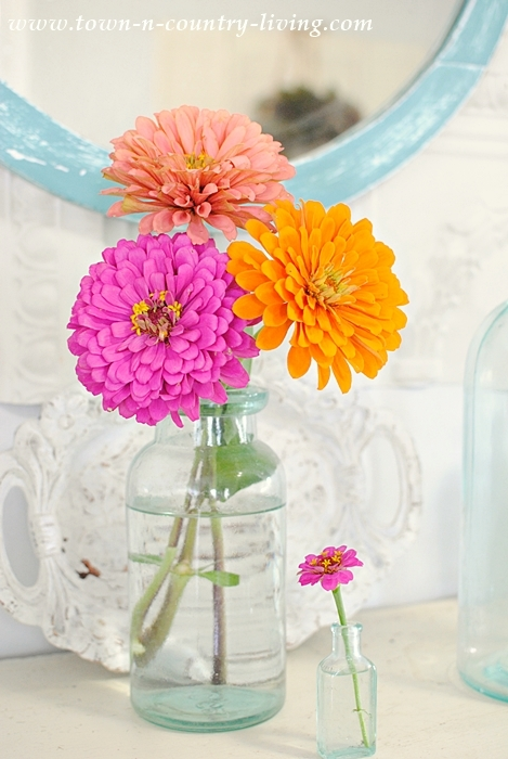 Summer Mantel of Vintage Bottles and Zinnias