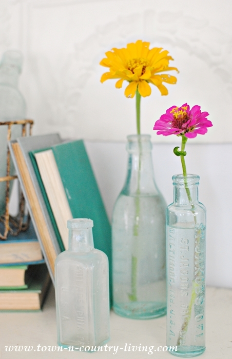 Summer Mantel with Vintage Bottles, Books and Zinnias