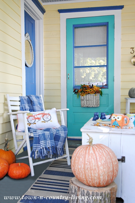 Fall Front Porch Decorated with Colorful Pumpkins and Flowers