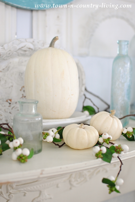 Little White Pumpkins Grace a Non-Traditional Fall Mantel