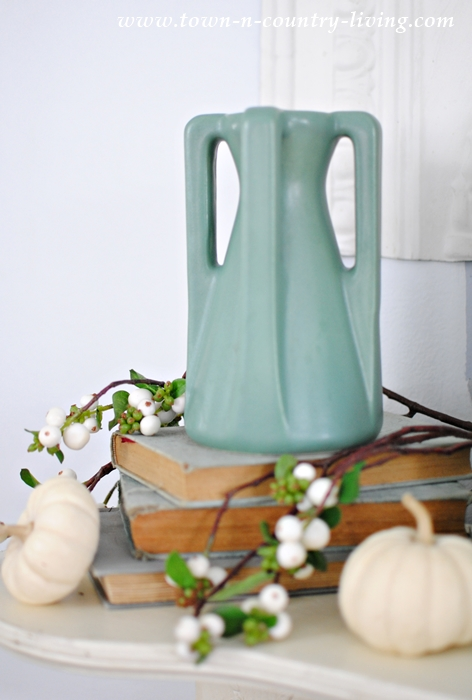 How to Create a Non-Traditional Fall Mantel with Vases, White Pumpkins, and Berries