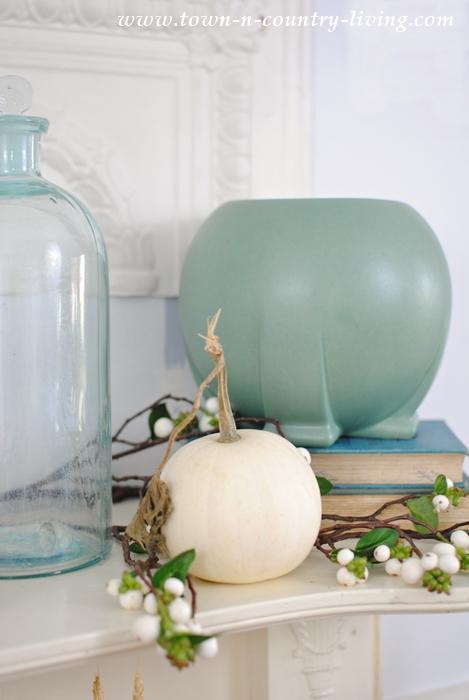Teco Art Pottery. The Orb Vase with a Mini White Pumpkin