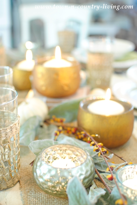 A variety of votive candle holders create a warm and inviting fall tablescape