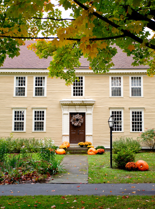 Over-sized Pumpkins Decorate a New England Colonial
