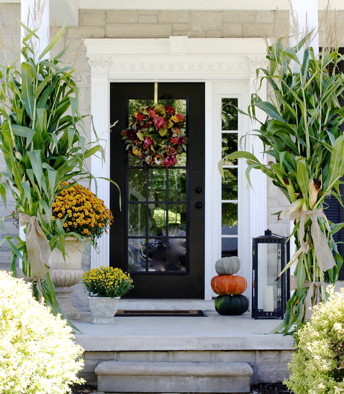 Pretty Fall Porch with Corn Stalks and Mums