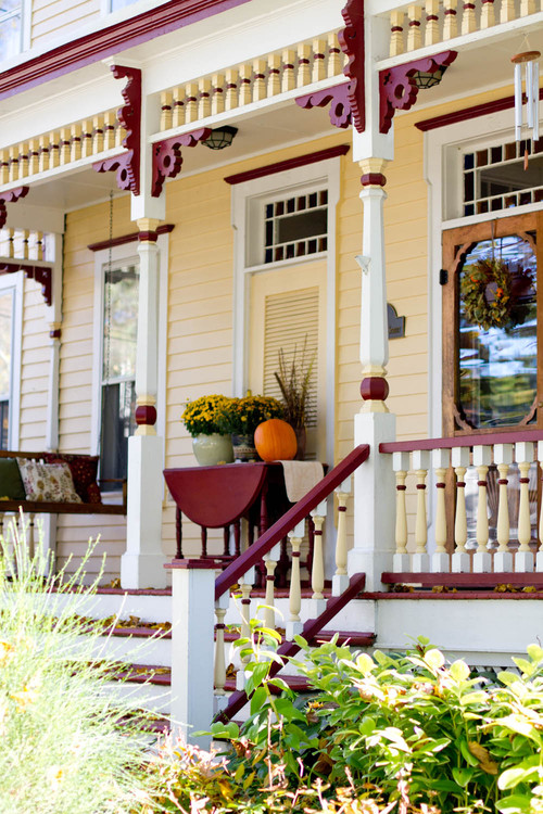 Victorian Fall Porch with Mums and Pumpkins