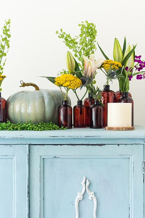 Fall Vignette of Brown Bottles and Fall Flowers