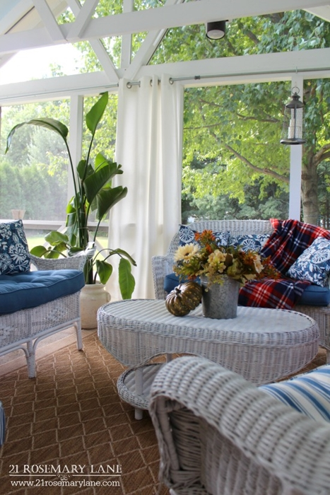Screened In Porch with White Wicker Furniture