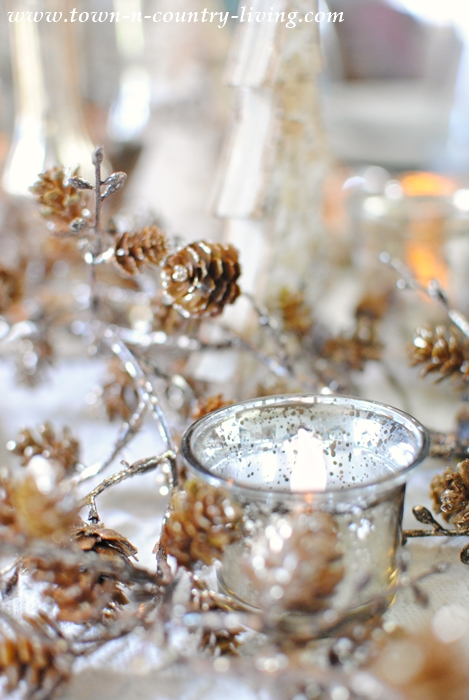 Candles and Bronzed Acorns Create a Glowing Centerpiece