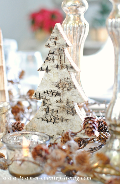 Rustic and Glam Centerpiece using bark-finished trees and bronzed acorns