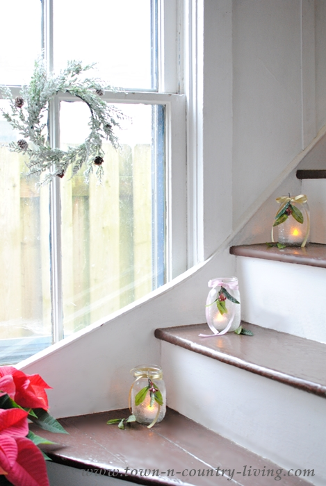 Stairway lined with mason jar votives for Christmas
