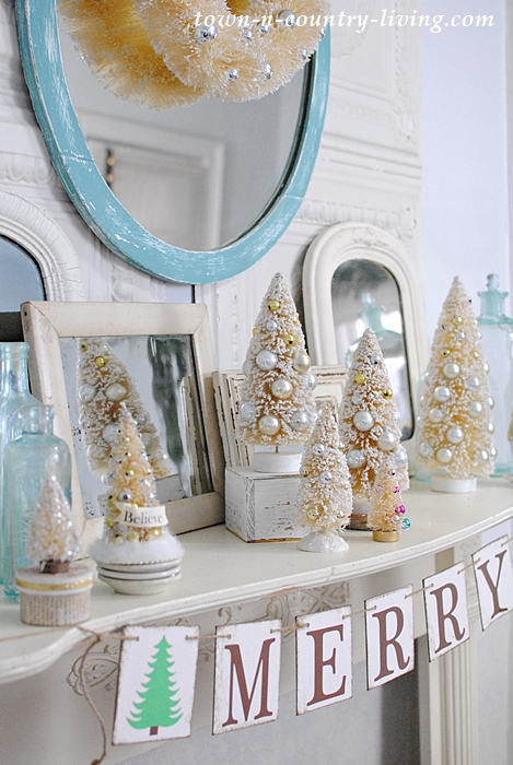Christmas Mantel with Bottle Brush Trees and Vintage Aqua Bottles