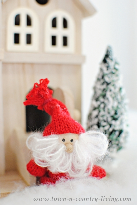 Create a Scandinavian Snowy Village on Your Christmas Mantel