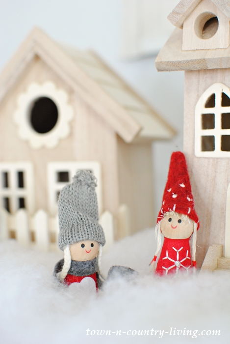 Create a Scandinavian style Christmas mantel using wooden bird houses.