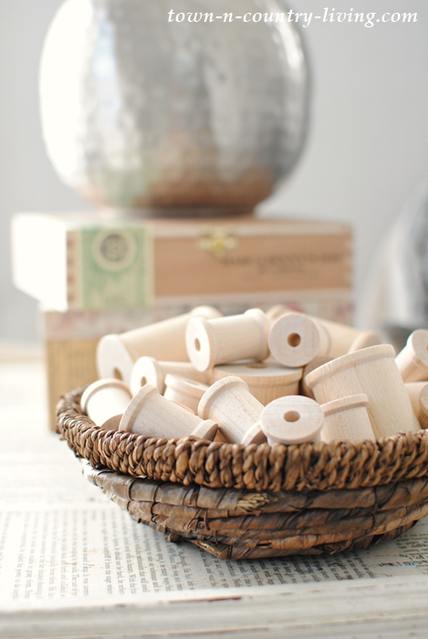 Basket of Wooden Spools for Simple Winter Decorating