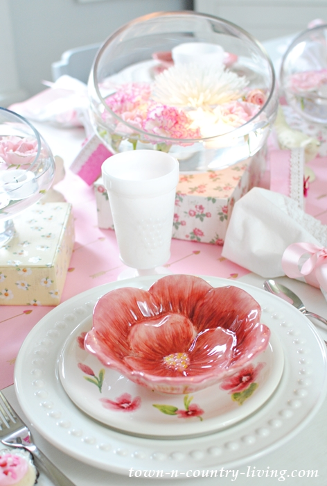 Pink Floral Dishes and a Bowl Full of Flowers Floating on Water