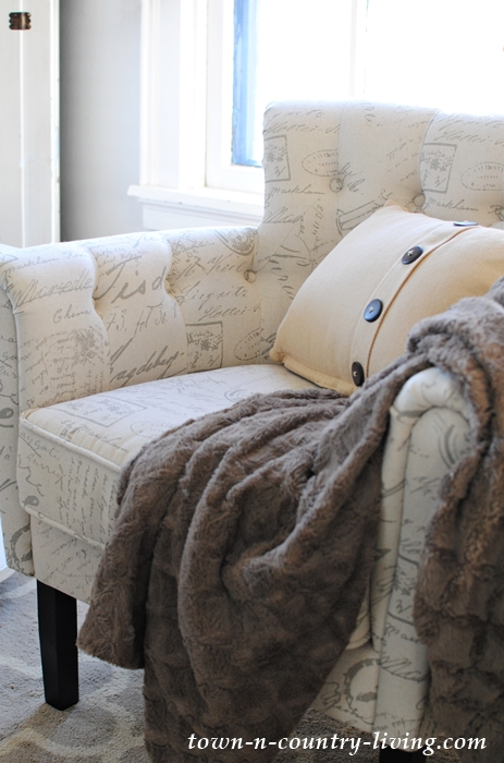 Tufted Script Chair with Brown Throw and Button Pillow
