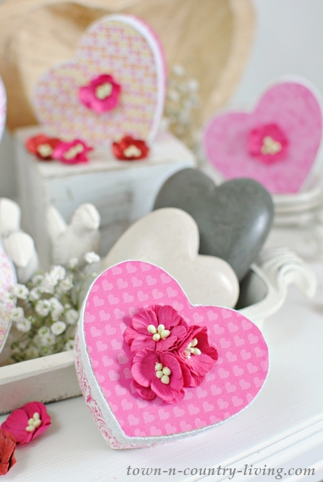 see how to make pretty valentine boxes from plain brown paper mache forms