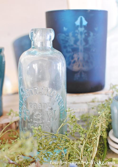 Vintage Bottles and Blue Votive Candle Holders