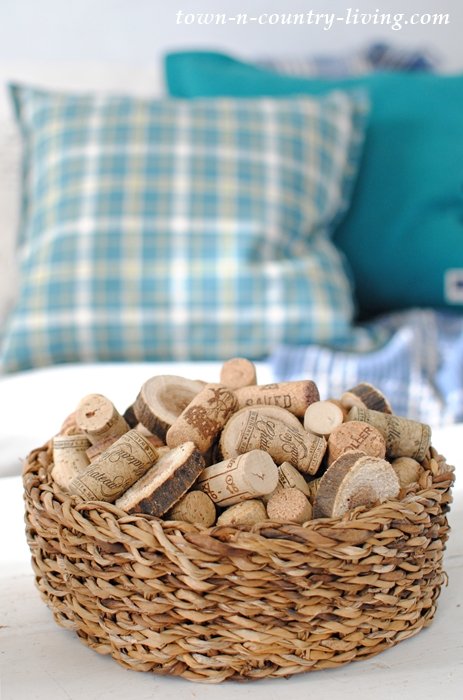Simple Winter Decorating. A Basket of Wine Corks and Wood Slices