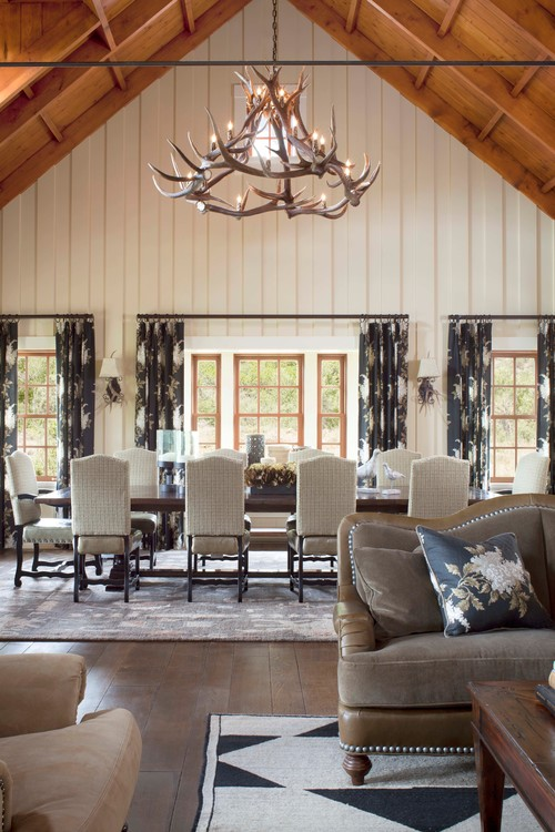 Rustic Dining Room with Vaulted Ceiling and Painted Paneling
