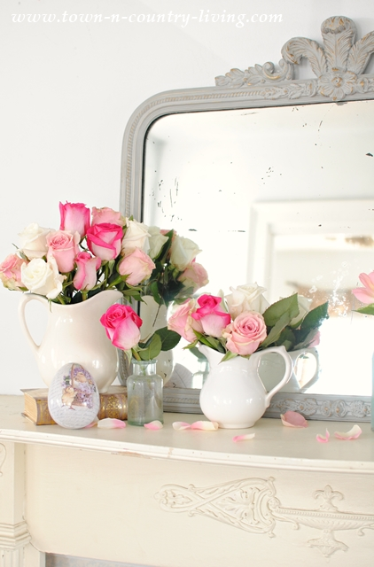 Spring mantel with white ironstone pitchers and pink roses