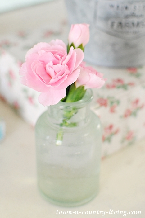 spring vignette, spring decor, vintage bottle, carnation, flower stem