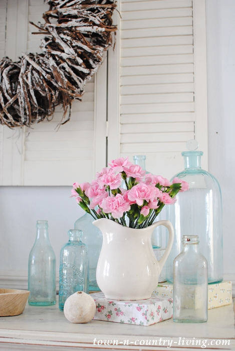 spring vignette, spring decorating ideas, spring decor, vintage bottles, ironstone pitcher