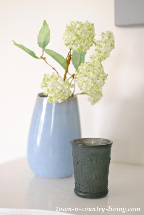leaning blue vase, spring decor, white flowers, blue votive