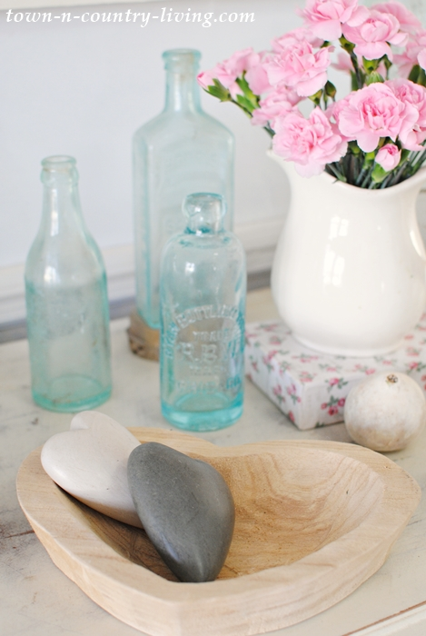 spring vignette, spring decorating ideas, spring decor, vintage bottles, ironstone pitcher, wooden heart bowl
