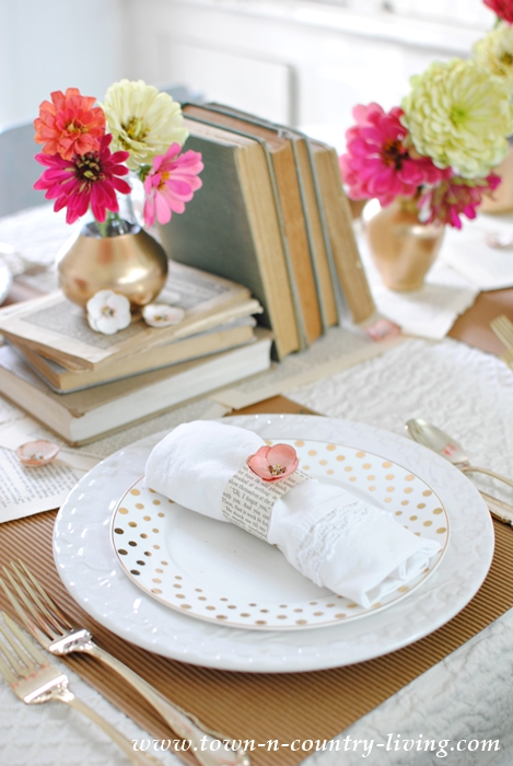 spring table setting, tablescape, pink and gold table setting, vintage books, book page runner, gold painted vases, simple flower arrangement, spring decor, spring decorating ideas