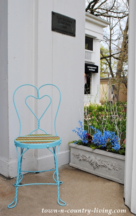 blue ice cream parlor chair, flower box, spring decor