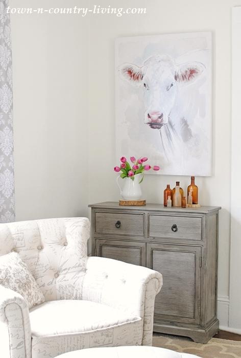 farmhouse cow painting, script chair, gray cabinet, sitting room, living room, den, farmhouse style, farmhouse decorating ideas, wall art, wall decor