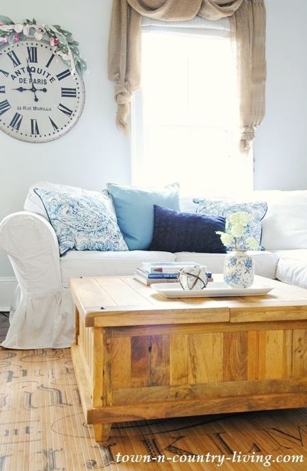 family room, farmhouse style, wood coffee table, white slip covers, sectional sofa, living room