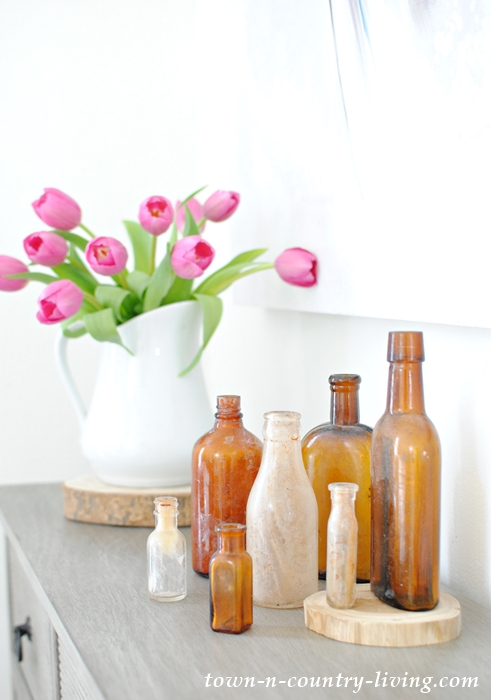 brown bottles, vintage bottles, spring vignette, pink tulips, white ironstone pitcher, spring decor, spring decorating ideas