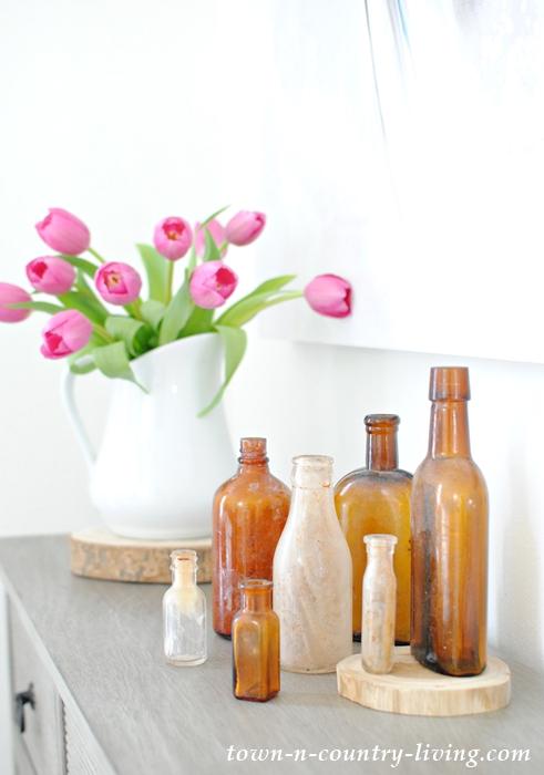 brown bottles, vintage bottles, spring vignette, pink tulips, white ironstone pitcher, spring decor, spring decorating ideas