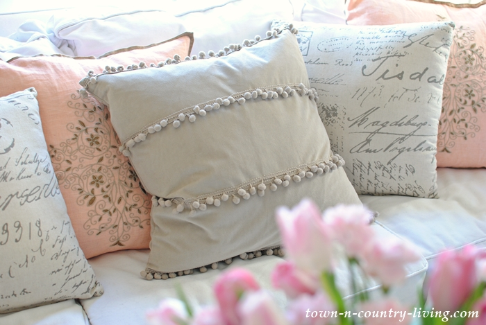 decorating with pillows, textured pillow, pom pom pillow, living room, family room, script pillow