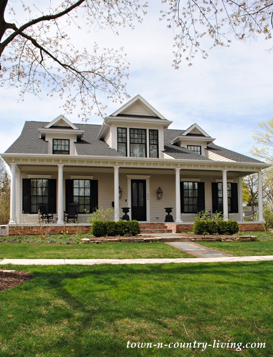 prairie style home, front porch, clapboard siding, dormer windows
