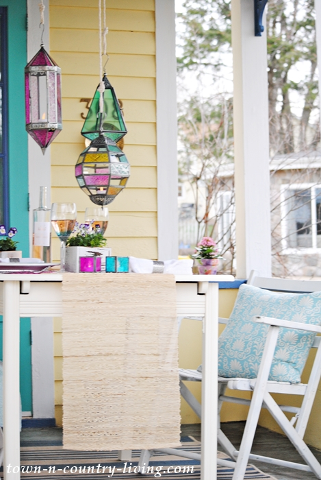 spring porch dining, boho chic, table setting, tablescape, jewel tone table setting, outdoor dining