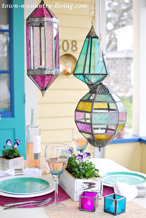 spring porch dining, boho chic, Moroccan lanterns, jewel tones, table setting, tablescape, dining al fresco