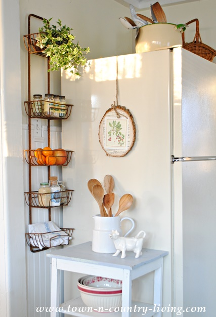 tips for organizing your home, wire wall basket, kitchen organization, organizing spices