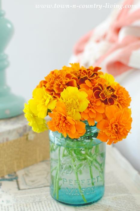 decorating with flowers, marigolds in mason jar