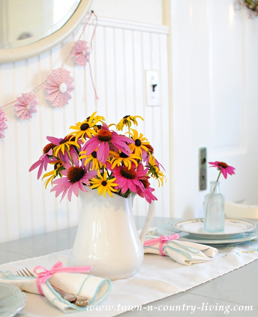 decorating with flowers, coneflowers, rudbeckia, white ironstone pitcher, flower arrangement, floral centerpiece, farmhouse style