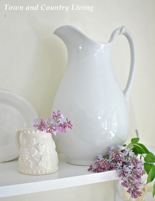 White ironstone pitchers and platters, a favorite country collectible.