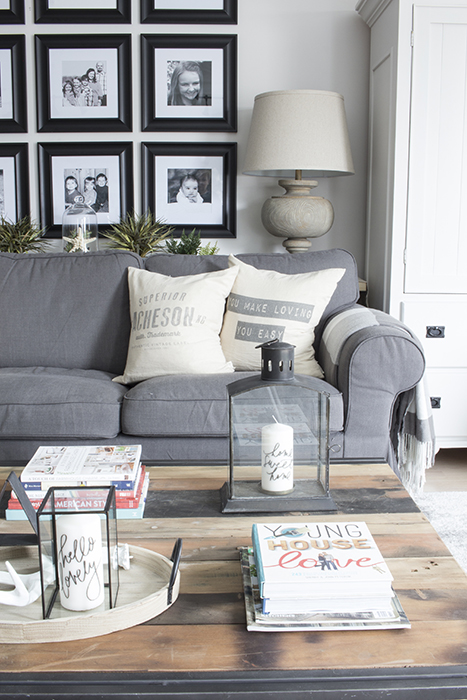 AKA Design reclaimed wood coffee table grey slipcovered couch
