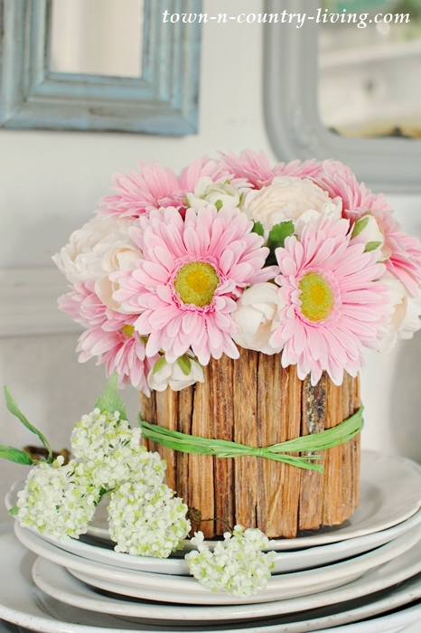 DIY rustic flower vase with pink gerbera daisies and ranunculus