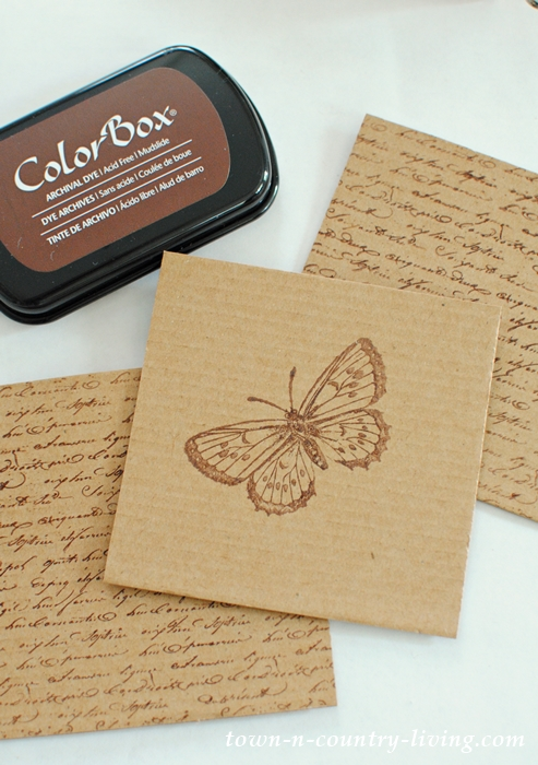 Make DIY coasters by recycling cardboard and decorating with stencils