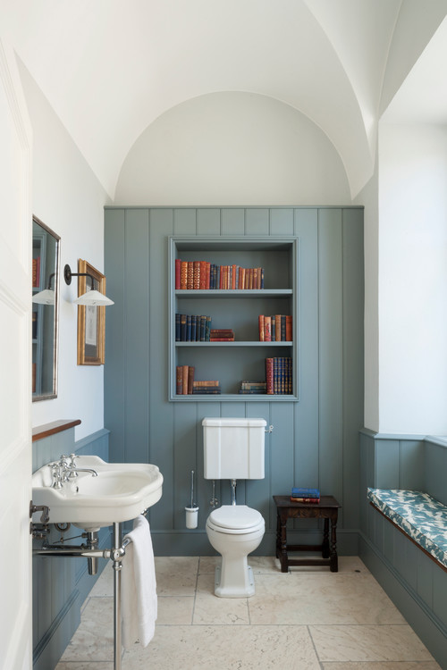 Vintage Blue Bathroom with Built-In Bookcase
