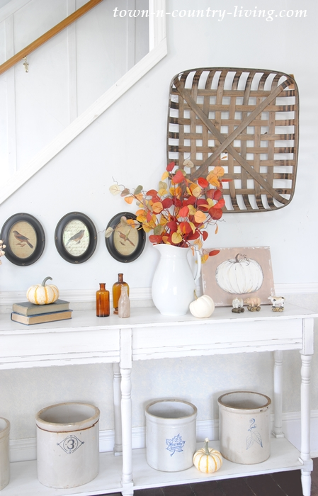 Farmhouse console decorated for fall